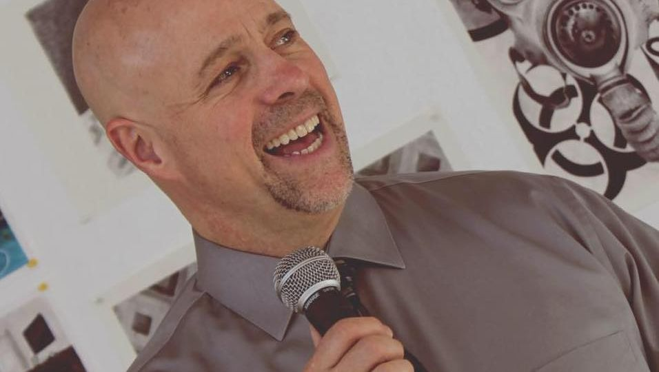 Image of person speaking with a microphone