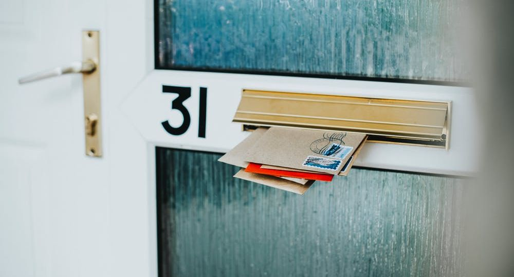 Image of mail sticking out of a mail slot