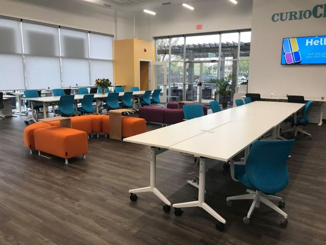 Image of work area set up with tables and chairs