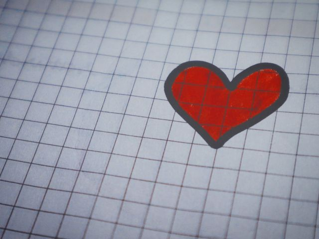 Red and black heart drawn on graph paper